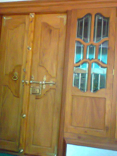 Kerala front double door designs joy studio design for Main double door design