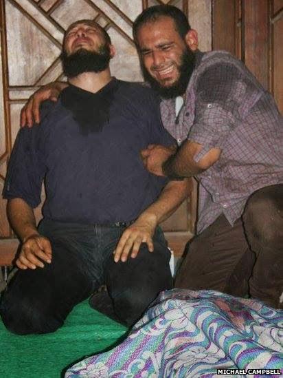 صور تُنشر لأول مرة لأحداث ميدان الجيزة ونفق الهرم أثناء مذبحة الفض 1470137_10202609931949939_1104497895_n