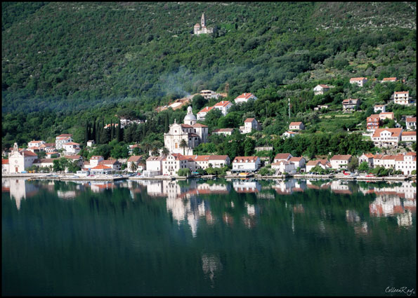 Shoreline views reflected in the Bay of Kotor.