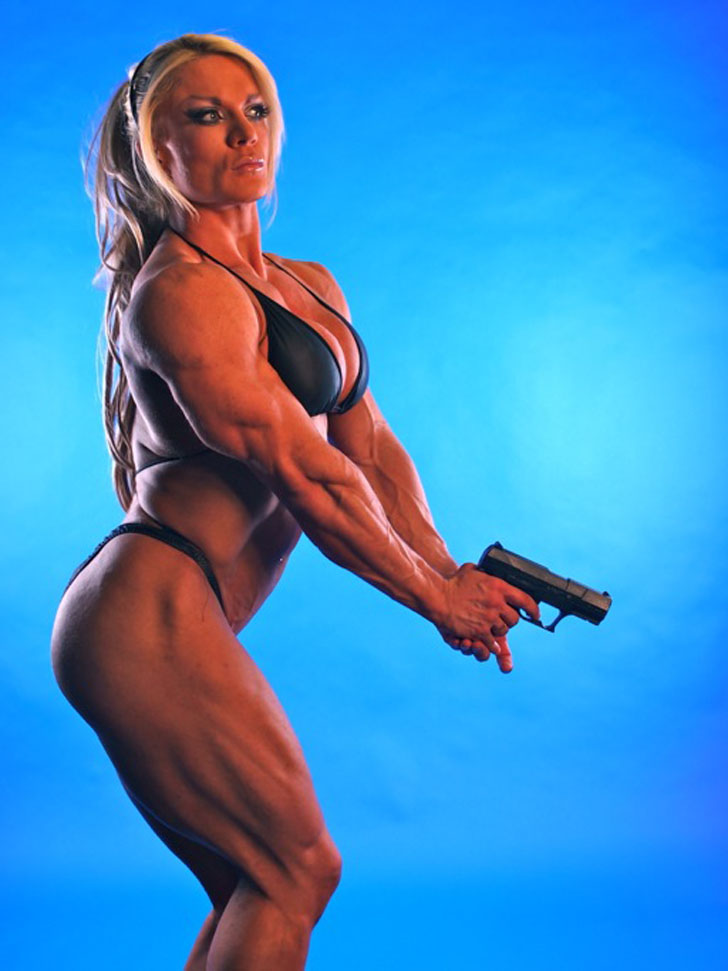 Lisa Cross Models Her Muscular Body In A Bikini While Gripping A Pistol