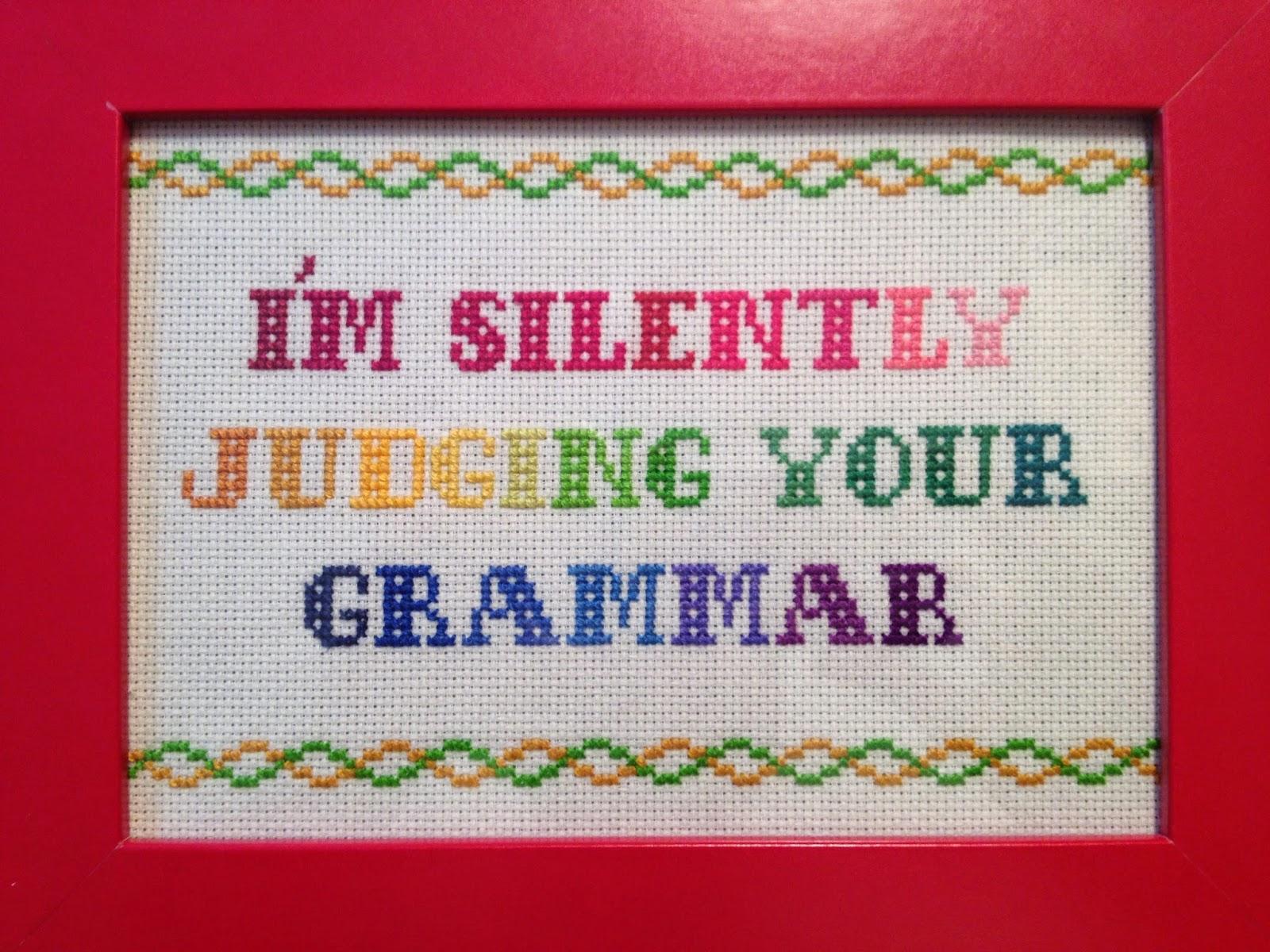Korsstingsbroderi i mange farver. I'm silently judging your grammar. Korssting, broderi, humor.