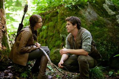 Jennifer Lawrence and Liam Hemsworth as Katniss and Gale on the set of The Hunger Games