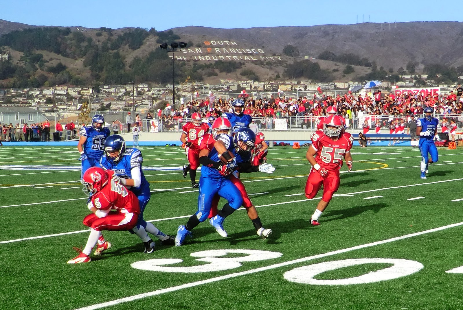 South City's Eric Kamelamela is brought down on a run during the first half of the 2014 Bell Game.