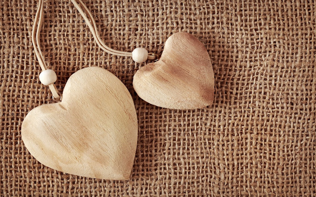 Two Wooden Hearts On Fabric