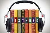 Books with headphones around them