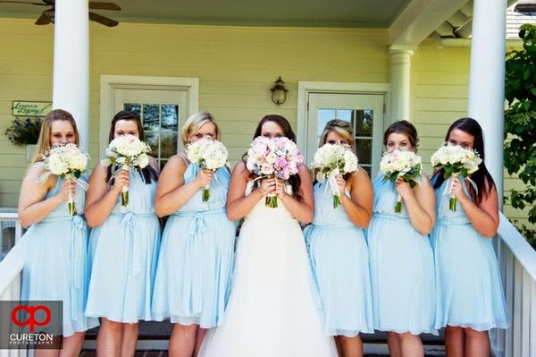 bridesmaids in light blue chiffon dresses