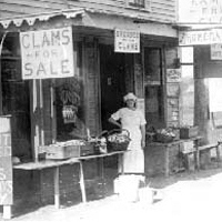 a woman standing in front of the clam shack