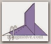 Bước 10: Gấp lộn ngược hai lớp giấy xuống dưới.