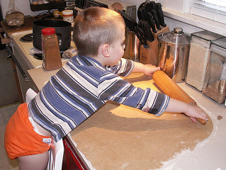 Making cinnamon rolls for Jazzy's birthday by Chris and Jenni, on Flickr
