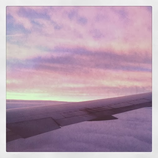 Pink sunrise over clouds from the plane