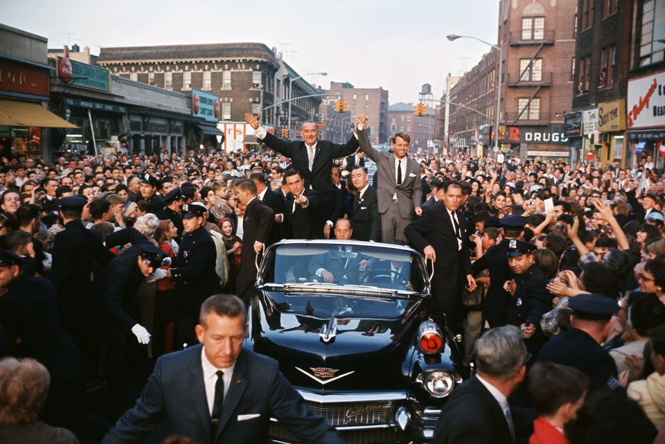 ATSAIC Art Godfrey (front of limo), ASAIC Lem Johns (pointing) and other agents with LBJ and RFK
