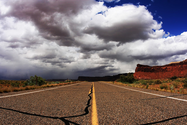 Storm clouds rolling in over the drive into Canyonlands National Park in Utah.