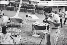 ELLIOTT ERWITT USING A BRONICA S MEDIUM FORMAT CAMERA PHOTOGRAPHED BY OKKY OFFERHAUS.JAMAICA.1964