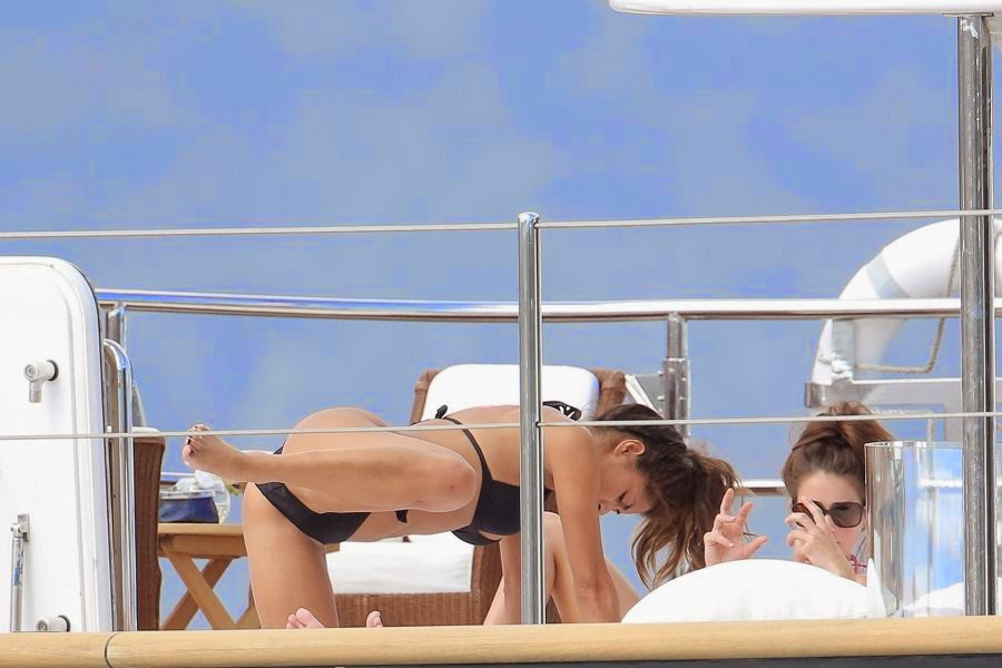 The 35-year-old appeared in high spirits as she soaked up the sunshine on a luxury yacht in Monaco on Sunday, May 25, 2014 with boyfriend, Lewis Hamilton and female friend, Louis Walsh.