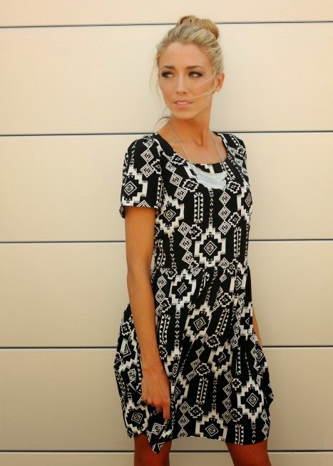 http://bellaellaboutique.com/product/aztec-dress-in-black-and-white/