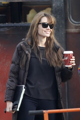 angelina jolie enjoying a hot coffee