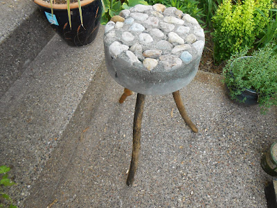 Rustic bucket stool made of concrete