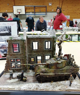 A model bombed-out building and tank diorama at a scale model exhibition.