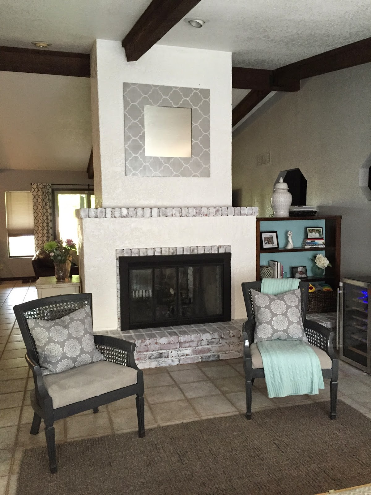 reimagined how to paint a brick and stucco fireplace
