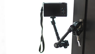 A Canon Powershot S95 modified with the CHDK Hack taking a time lapse video mounted using a flexible arm and clap