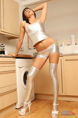 Tight shiny silver spandex top and shorts.... Delicious...