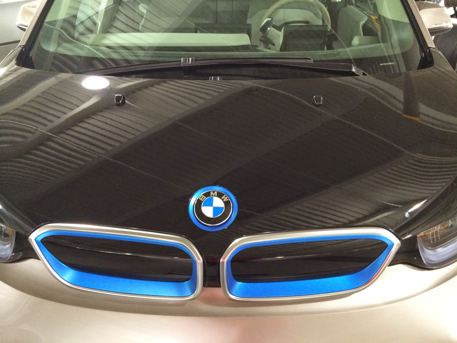 The 2014 BMW I3 Is Available As An All Electric Vehicle Or A Plug In Hybrid Grille And Hood Badge Are Familiar Above But Carbon Fiber