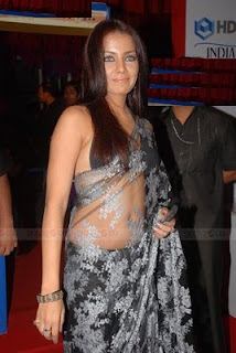 Celina Jaitley in black & white stripe transparent saree