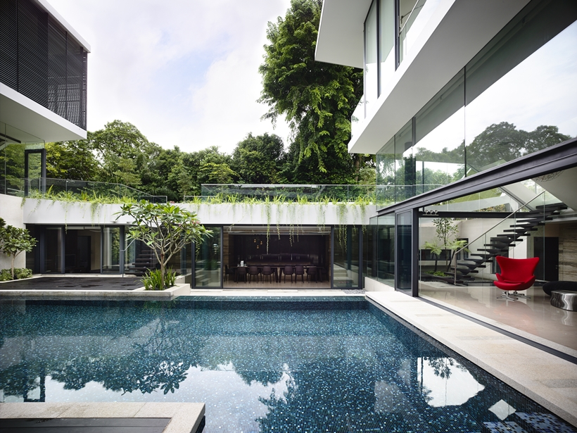 Swimming pool and terrace in an Impressive dream home in Singapore by a-dlab