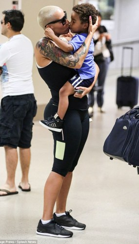 Pics: Amber Rose showers her 2yr old son with kisses at the airport