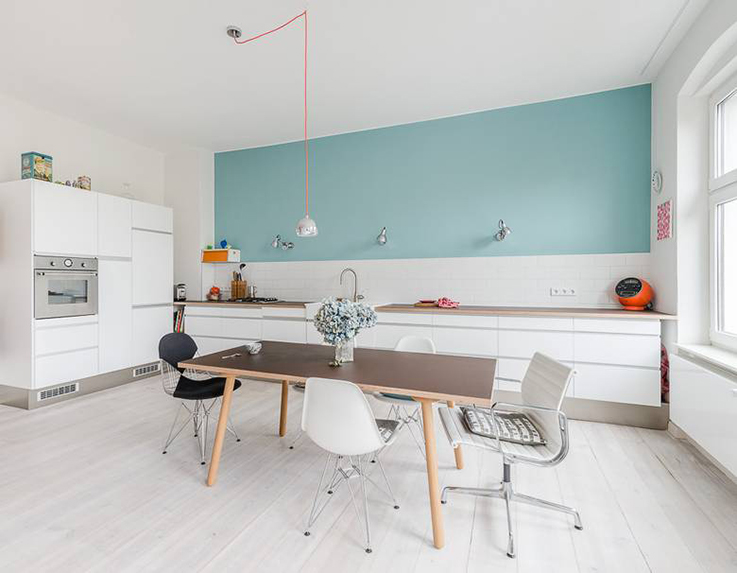white kitchen with light blue wall