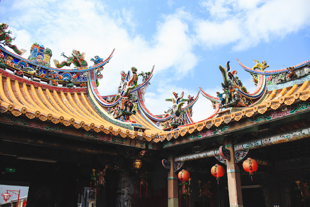 swooping temple rooflines, colorful dragons and red lanterns | Beipu, Taiwan