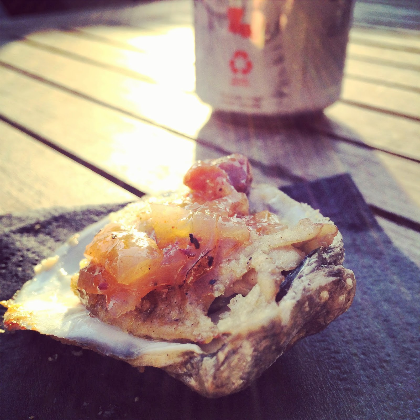 Charbroiled Louisiana Gulf Oyster with Herbed Lemon-Horseradish Brown Butter