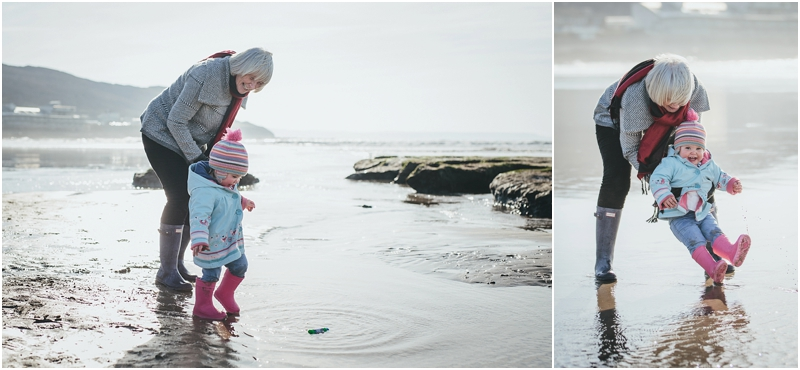 A grandmother with her granddaughter on the beach
