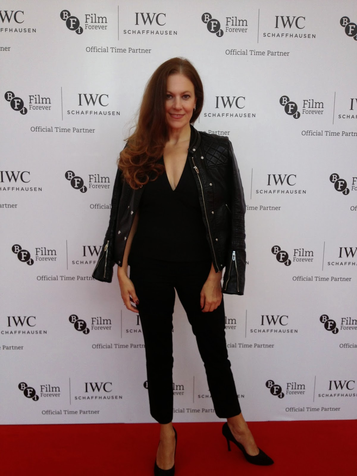 Standing out: The chic trouser suit showed off the bloggers enviable slim figure