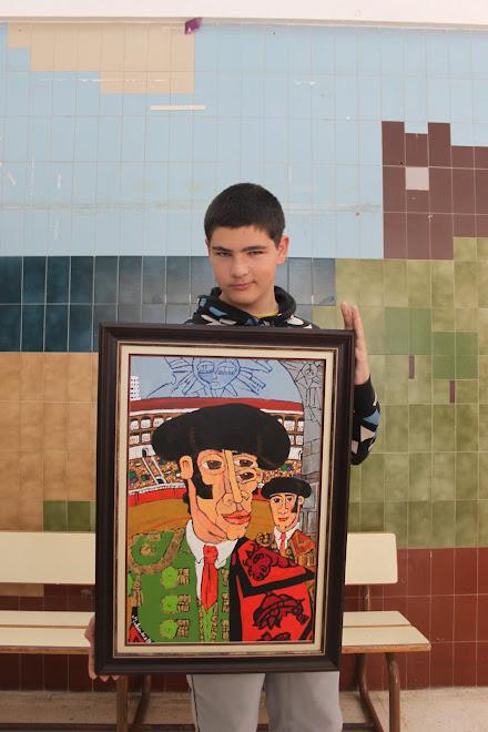 Josep hijo de Paco con el cuadro.