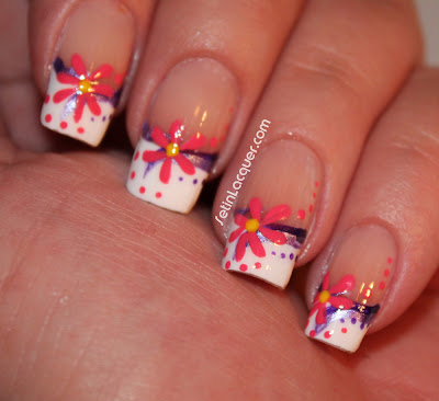 Traditional french tips with floral nail art.