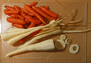 Parsnips and Carrots on Cutting Board
