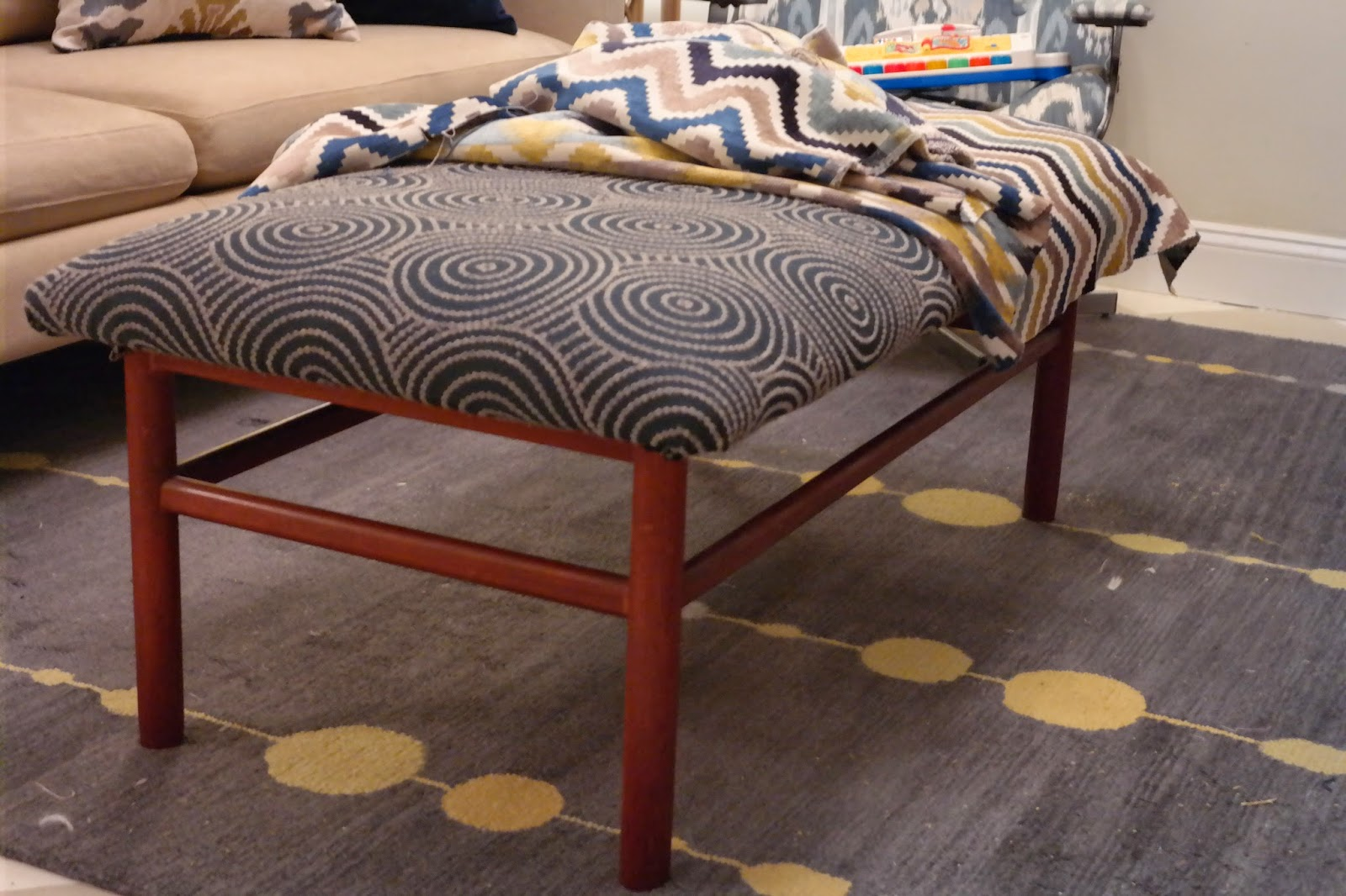 D-I-Y Tutorial: How To Recover An Ottoman or Turn a Coffee Table into an  Ottoman.