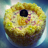 lemon buttercream cake with sprinkles and pink butterflies