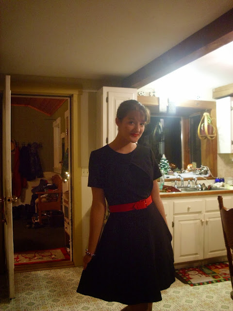 Christmas outfit black dress red belt lipstick via Young Yankee Lady