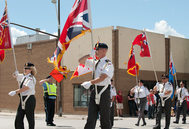 Colour guard from the Royal Canadian Legion marching on Canada Day