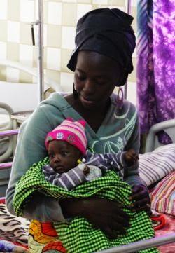 sticka Till Nyfödda i Gambia