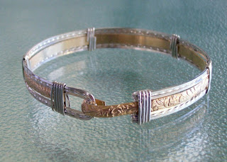 http://surfandsandjewelry.com/product/floral-14k-gold-filled-sterling-bangle/