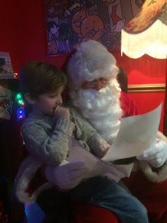 Santa reading little boy's letter
