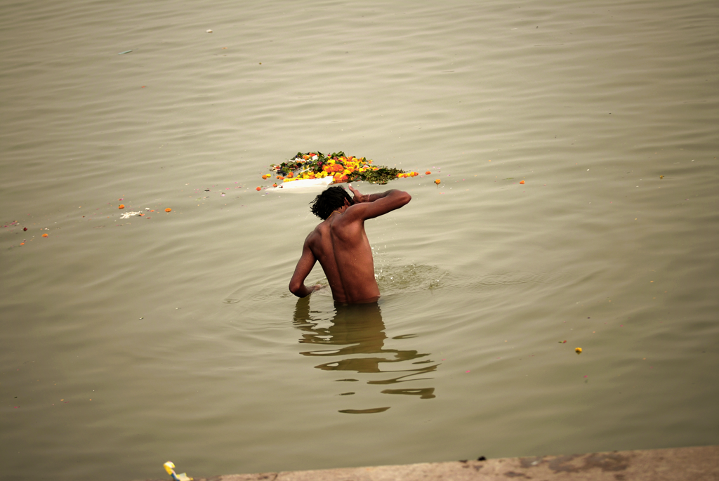 Photo of a morning bath in the Ganges River in Varanasi in Uttar Pradesh, India.