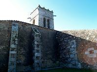 El campanar i els contraforts de l'església de Santa Maria del Socors del Corredor