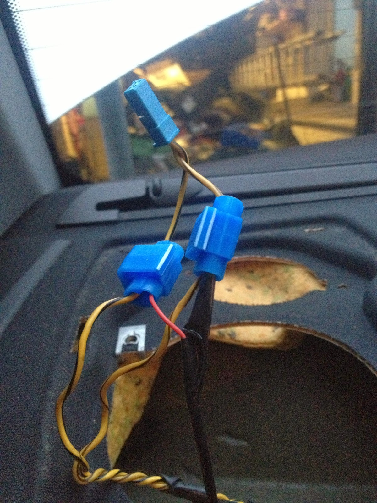 Push the wires down into the parcel-shelf and replace the speakers/grilles.