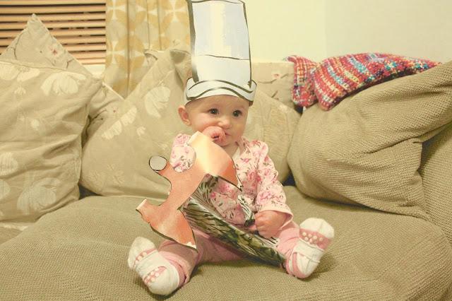 baby girl wearing paper top hat from McDonalds Roald Dahl Happy Meal