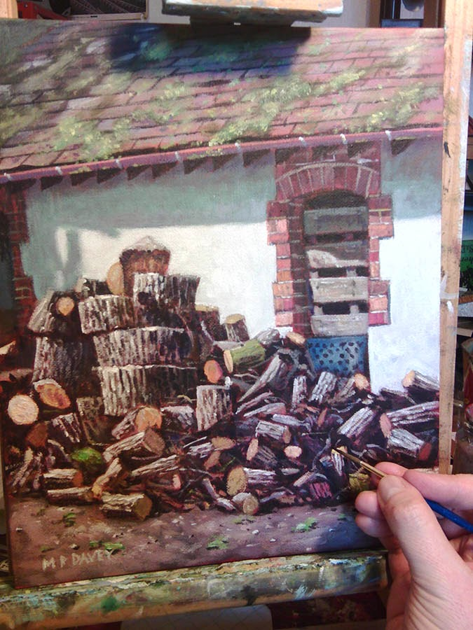 WIP on a painting of logs stored by shed - artist Martin Davey