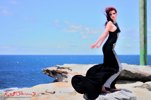 Full length Christopher Morro high fashion couture dress, on location.